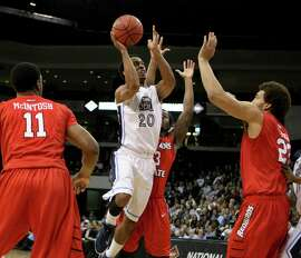 Old Dominion's Trey Freeman (20), slashing through the lane in Monday night's victory over Illinois State, hit the game-winning basket in Wednesday's quarterfinal victory over Murray State. ODU will face Stanford in the semifinals at Madison Square Garden.