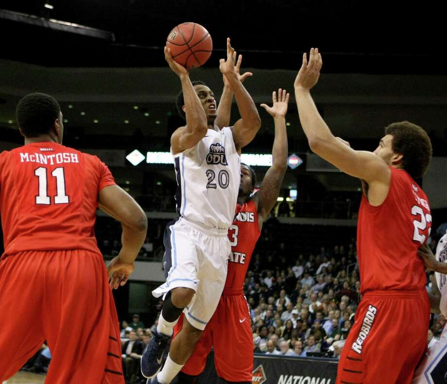 Old Dominion's Trey Freeman (20), slashing through the lane in Monday night's victory over Illinois State, hit the game-winning basket in Wednesday's quarterfinal victory over Murray State. ODU will face Stanford in the semifinals at Madison Square Garden. Photo: Jason Hirschfeld / Associated Press / FRE170070 AP