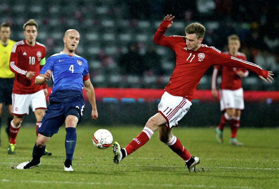 Michael Bradley (blue) of the U.S. defends against Denmark's Nicklas Bendtner, who had a hat trick in the Danes' 3-2 friendly victory at NRGI Stadium in Aarhus, Denmark. Photo: Jens Dresling / Associated Press / Polfoto