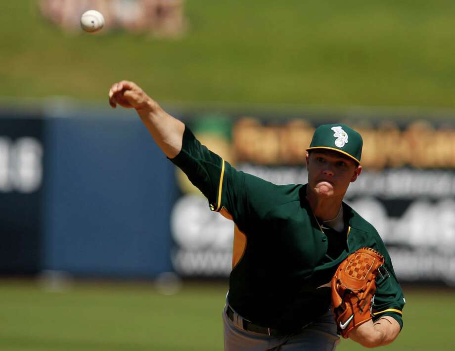 Starting pitcher Sonny Gray delivers in the first inning of a spring training game against the Brewers in Phoenix. Gray was hit hard in the second inning and then got wild in the third is his worst start of the spring. Photo: Rick Scuteri / Associated Press / FR157181 AP