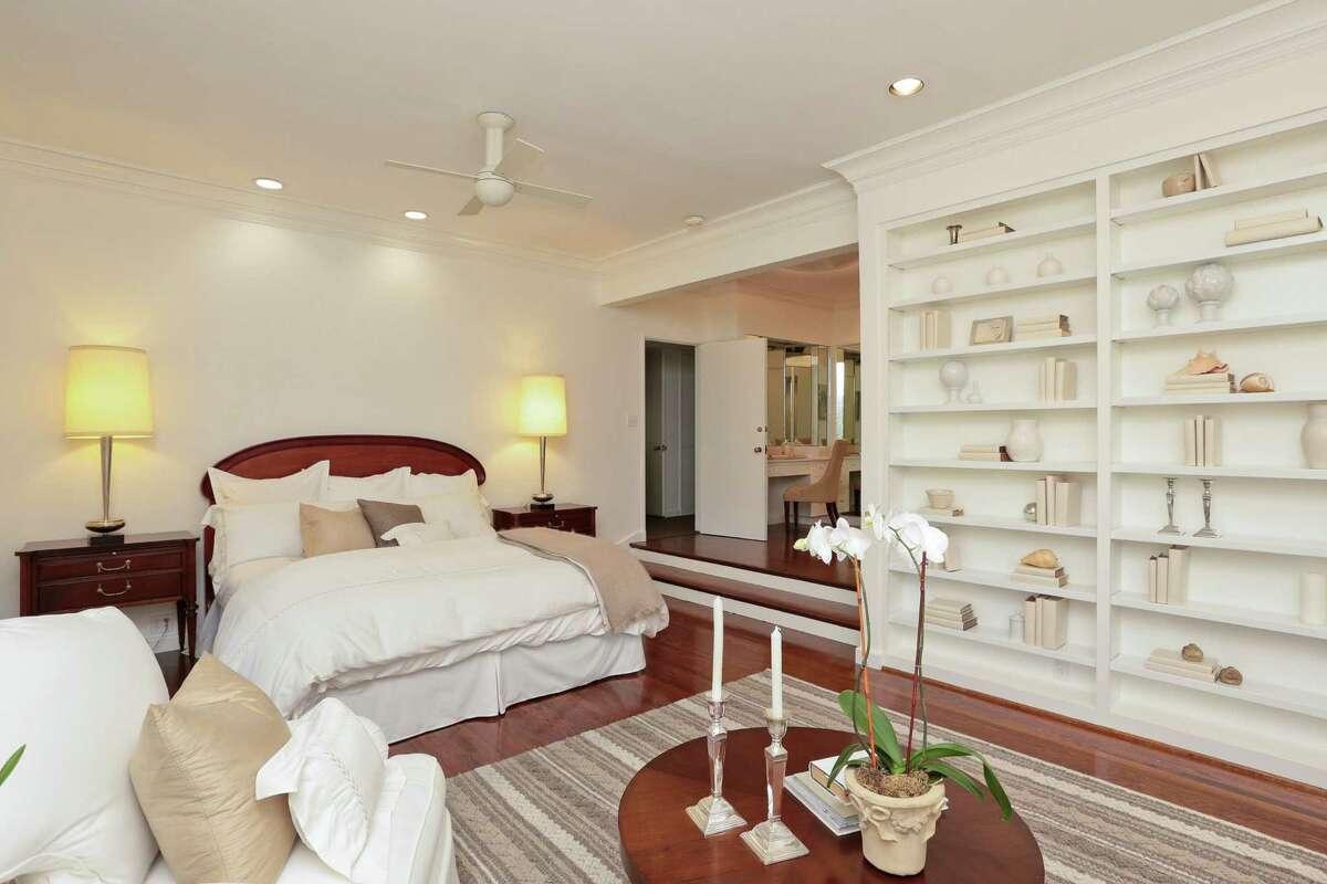 Floor-to-ceiling built-ins highlight this sunken bedroom.