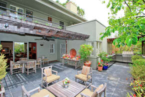 The spacious tile patio includes a built-in barbecue.