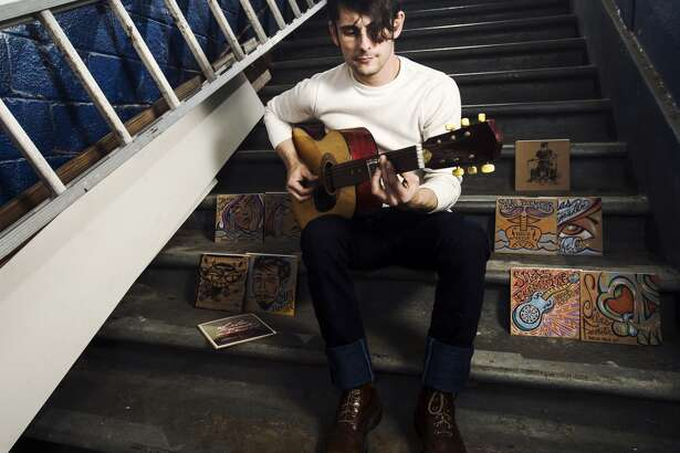 """Silas Feemster poses for a photo Monday afternoon. Wrong Side of Texas Records, a record label that only releases local artists on vinyl, is set to release an EP of vintage blues guitar music by Beaumont native Silas Feemster. Feemster's album, """"Parlor Trick,"""" will the Beaumont record label's second release. Photo taken Monday 3/16/15 Jake Daniels/The Enterprise"""