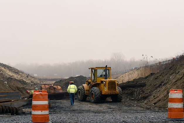 It was pretty foggy out Thursday morning but that wasn't keeping construction crews from starting their work at the Northway overpass over Albany Shaker Road in Colonie. (Skip Dickstein / Times Union)
