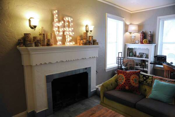 """The Helseth family home was built in 1933 and has the original tile and mantel. The lighted """"Love"""" sign was purchased from Etsy."""