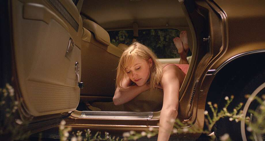 "This image released by RADiUS shows Maika Monroe in a scene from ""It Follows."" (AP Photo/RADiUS) Photo: HONS / RADiUS"
