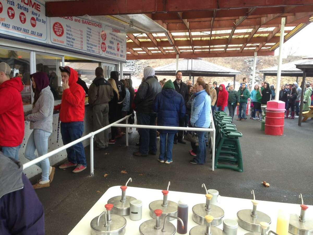 People lined up Thursday morning to order at Jumpin' Jack's Drive-In in Scotia. The burger stand on the banks of the Mohawk River opened for the season on Thursday. (Lori Van Buren / Times Union)