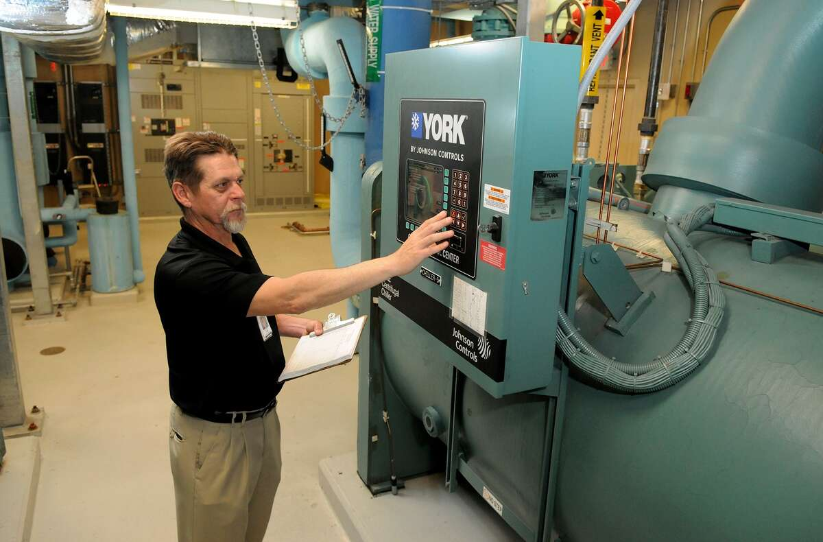 Les Brown, an engineering manager and 30-year employee at Memorial Hermann-The Woodlands, checks equipment operation in the central plant.