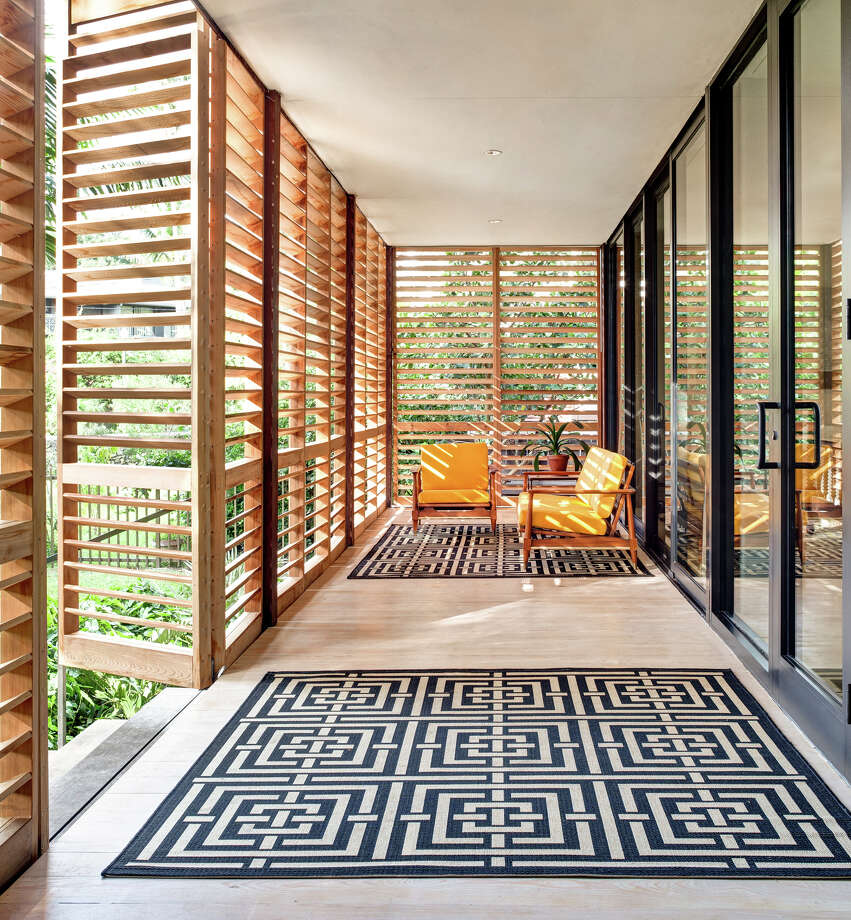 Style: Bungalow Built as an extension of the family living room, bungalow porches are rustic and may have chairs built with birch wood or other twig-style furniture. Floors are usually wood or plain concrete.  This home is in Miami, Flordia Photo: Courtesy New York Times / 518Life Magazine