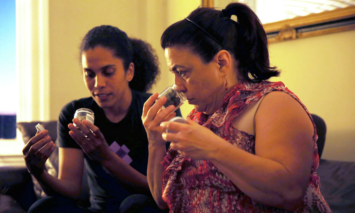 Isa Marie Perez (left) and Cathy Tateosian check out items at a sample and share cannabis product party in San Francisco.
