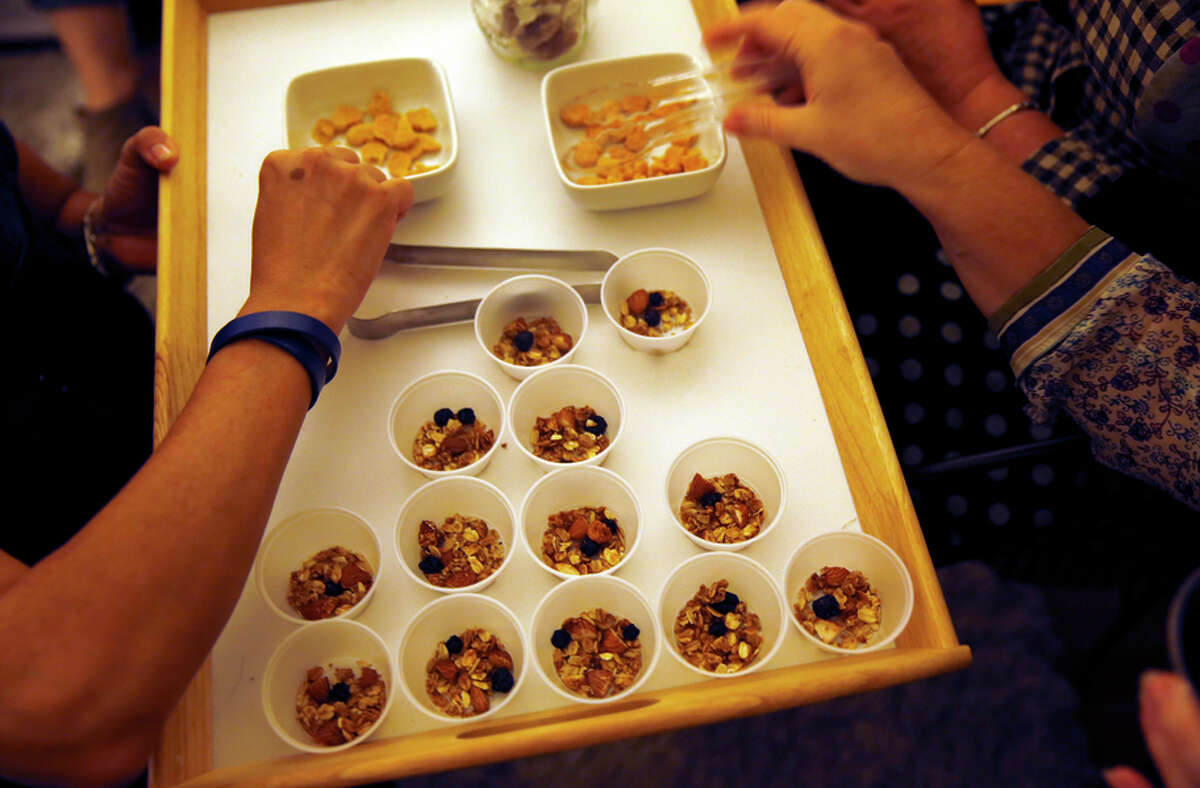Cannabis-product party guests sample edible treats made with marijuana, many specifically created with women in mind.