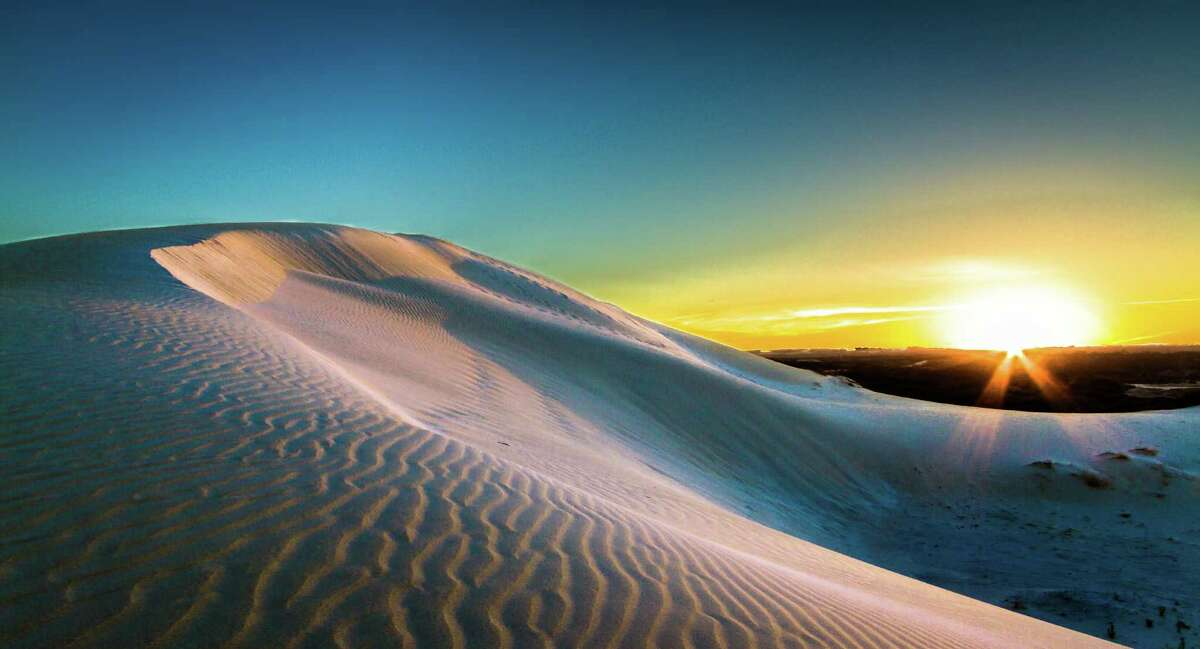 Most of Australia is a desert, with sunsets over massive sand dunes.