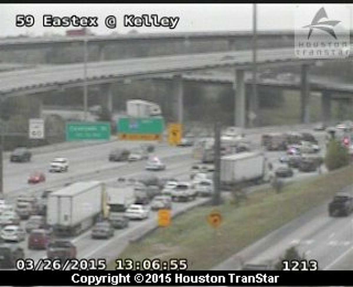 A seven-vehicle crash blocked portions of U.S. 59 Friday after a big-rig overturned, dumping a load of metal shavings on the roadway in north Houston.