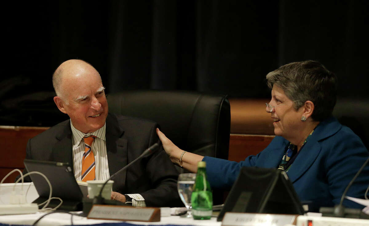 Gov. Jerry Brown and UC President Janet Napolitano converse after a recent briefing on their progress over tuition.