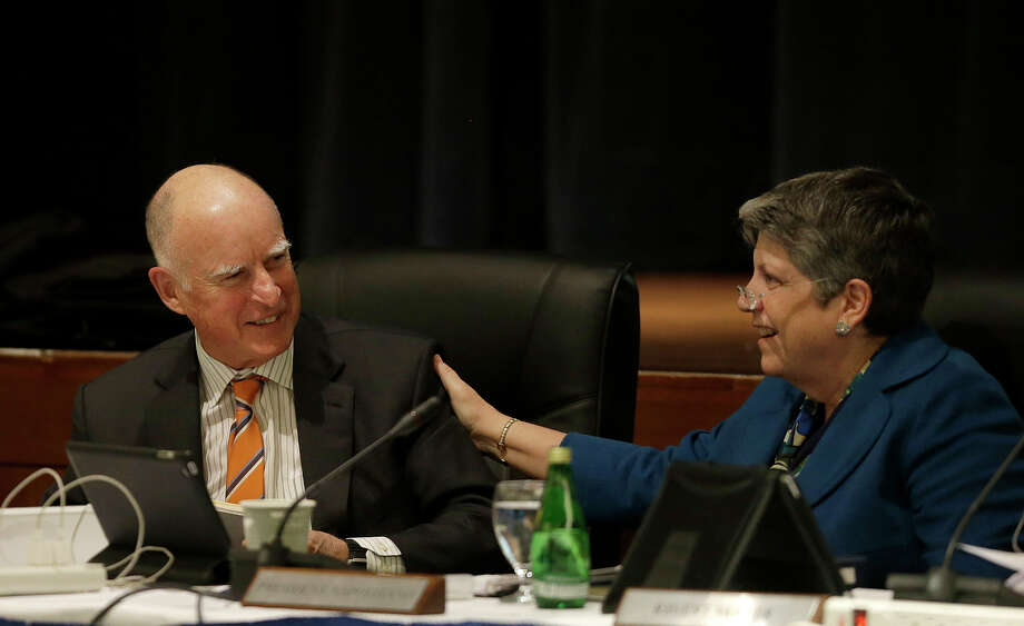 Gov. Jerry Brown and UC President Janet Napolitano converse after a recent briefing on their progress over tuition. Photo: Jeff Chiu / Associated Press / AP