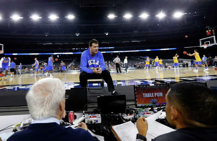 UCLA Bruins head coach Steve Alford sits on the sideline during the team's shoot around at NRG Stadium, Thursday, March 26, 2015, in Houston.