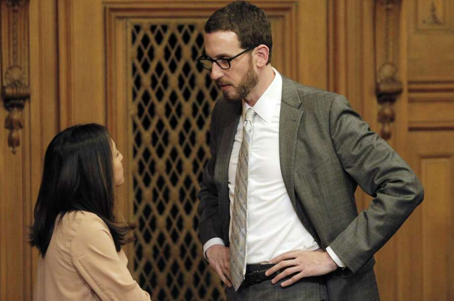 Supervisor Scott Weiner chats with Supervisor Katy Tang, left, before Tang's selection as interim board president on Tuesday. San Francisco Supervisors elected an interim board president on Tuesday, November 18, 2014, naming Katy Tang to replace David Chiu who will be stepping down to join the state assembly in December. The selection took place during the Board of Supervisors meeting at City Hall in San Francisco, Calif. Photo: Carlos Avila Gonzalez / The Chronicle / ONLINE_YES
