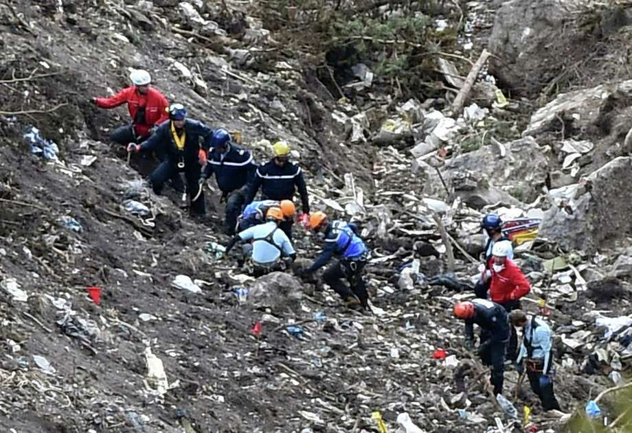 French police and investigators work in the scattered debris on the crash site of the Germanwings Airbus A320 that crashed in the French Alps. Photo: ANNE-CHRISTINE POUJOULAT / AFP / Getty Images / AFP