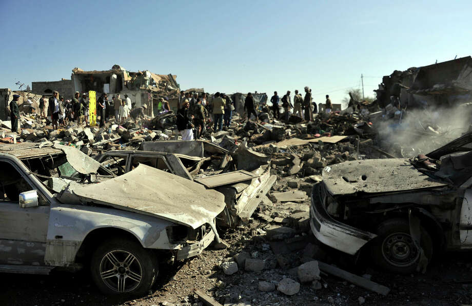 People gather at the bombed site near an air force base in the capital of Sanaa to search for casualties. Photo: Hani Ali / McClatchy-Tribune News Service / Zuma Press