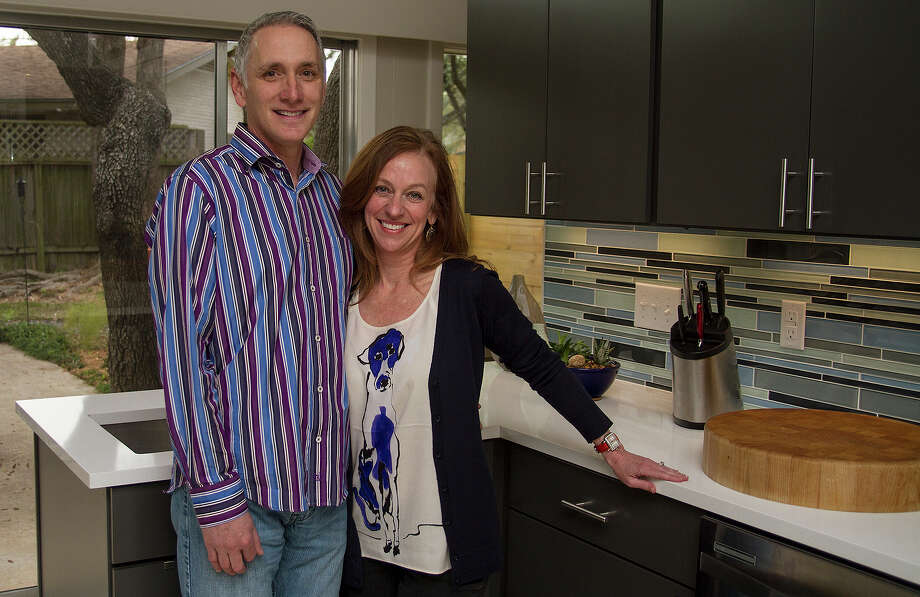 Laura and Jeff Hebert were committed to maintaining the midcentury modern aesthetic of their house when they remodeled the kitchen. They worked with Virtuoso Builders to make over the kitchen. Photo: Alma E. Hernandez /For The Express-News
