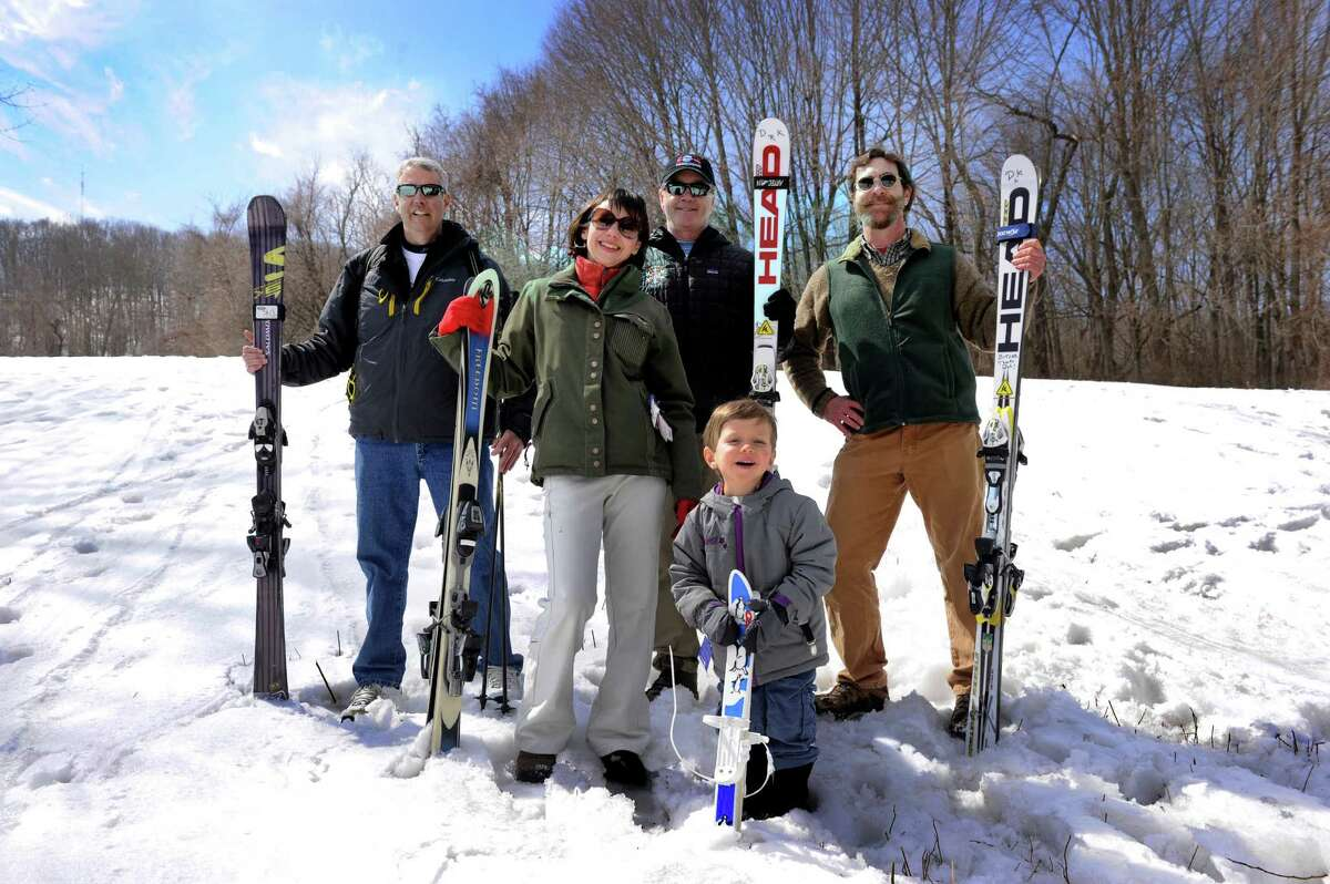 Some members of the Danbury Ski Club are photographed on what was once known as Mad Hatter Ski Slope in Danbury, Conn., Tuesday, March 24, 2015. They are from left Pat Howard, cuurent club president, Jessica Outlaw and son Daschel, 4, Dave Kiley, a past president and Dan Martin. The Danbury Ski Club is celebrating its 60th anniversary this year, 2015.