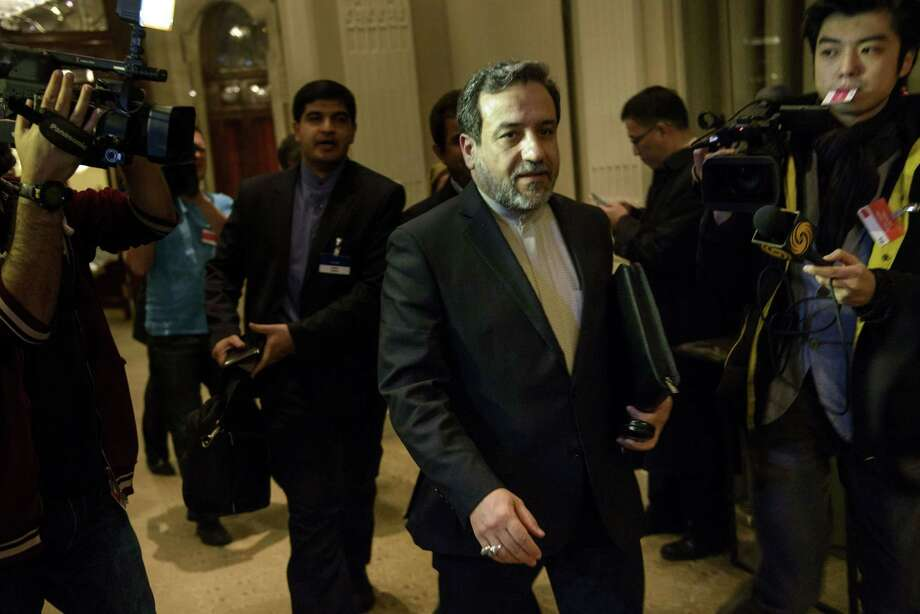 Iran Deputy Foreign Minister Abbas Araghchi walks past reporters after talks in Lausanne. Photo: BRENDAN SMIALOWSKI / AFP / Getty Images / AFP