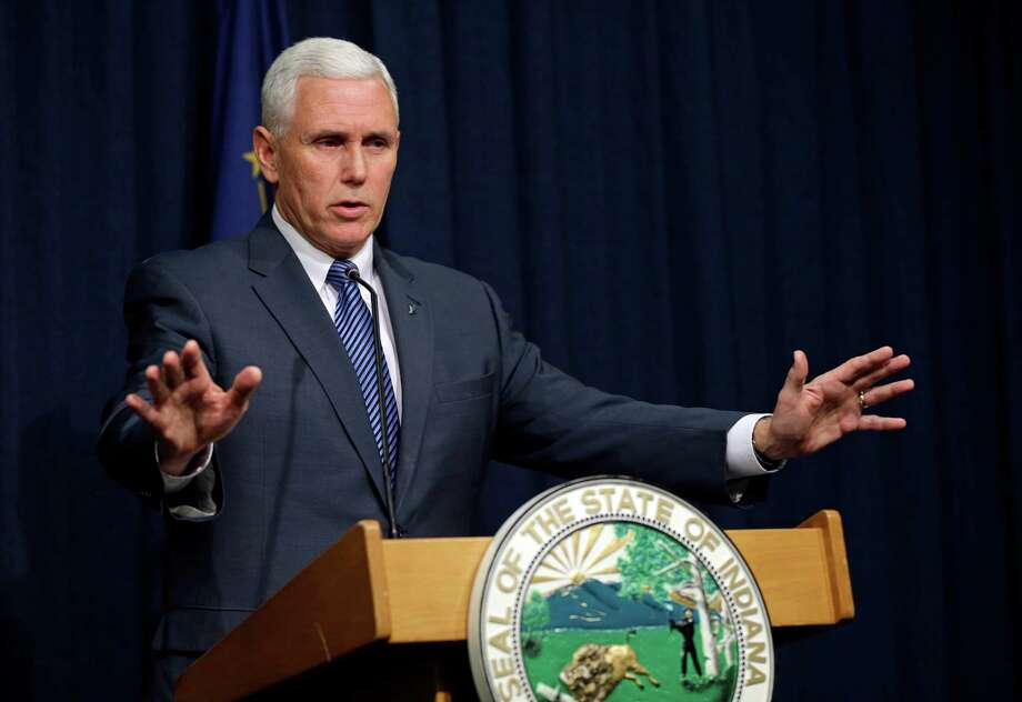 Gov. Mike Pence defends the law, which some say will permit discrimination against gays. Photo: Michael Conroy / Associated Press / AP