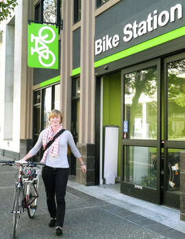 Colleen Sullivan picks up her bike from BART's new Uptown Oakland Bike Station.