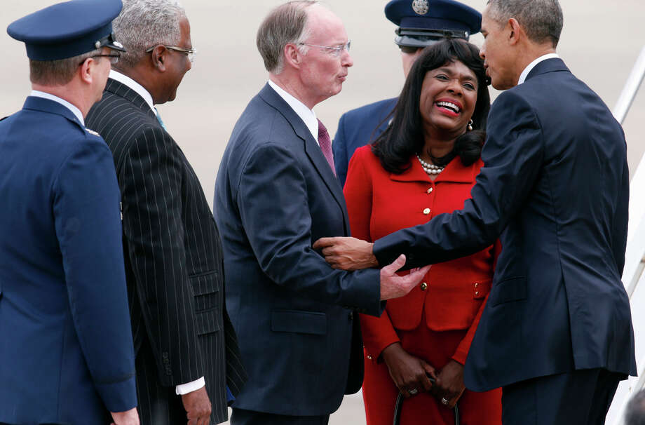 Alabama Gov. Robert Bentley (center) and other dignitaries welcome President Obama to the state, where he praised proposed new rules to protect borrowers. Photo: Hal Yeager / Associated Press / FR170776 AP