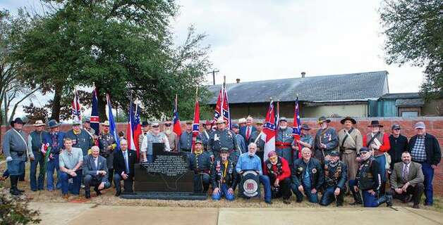 Confederate Veterans Memorial PlazaPalestine  Five flags of the Confederacy are flown at the memorial plaza in Palestine. Funded by the Sons of Confederate Veterans, the plaza opened in 2013. Pictured above, members of the SCV camp 2156 gathered in ceremony to dedicate a black granite plaque to veterans and families of the Confederacy.   Photo courtesy of the Sons of Confederate Veterans. Photo: Dylan Baddour
