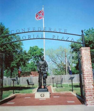 """Confederate Memorial PlazaAnderson The plaza beside the Grimes County courthouse flies a Confederate flag behind a gate with metal lettering reading """"Confederate Memorial Plaza."""" A metal statue depicts one of several Grimes County residents who fought with the 4th Texas volunteer infantry brigade in Virginia.  Photo: Dylan Baddour"""