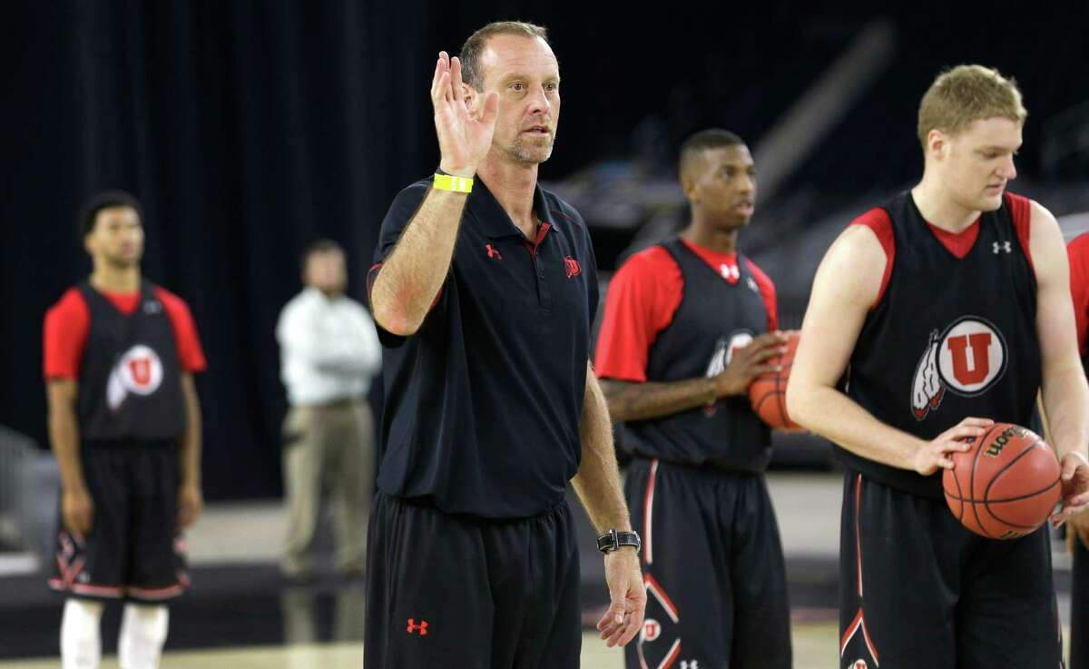 Utah head coach Larry Krystkowiak calls for a ball during practice for the NCAA South Regional at NRG Stadium on Thursday, March 26, 2015, in Houston.