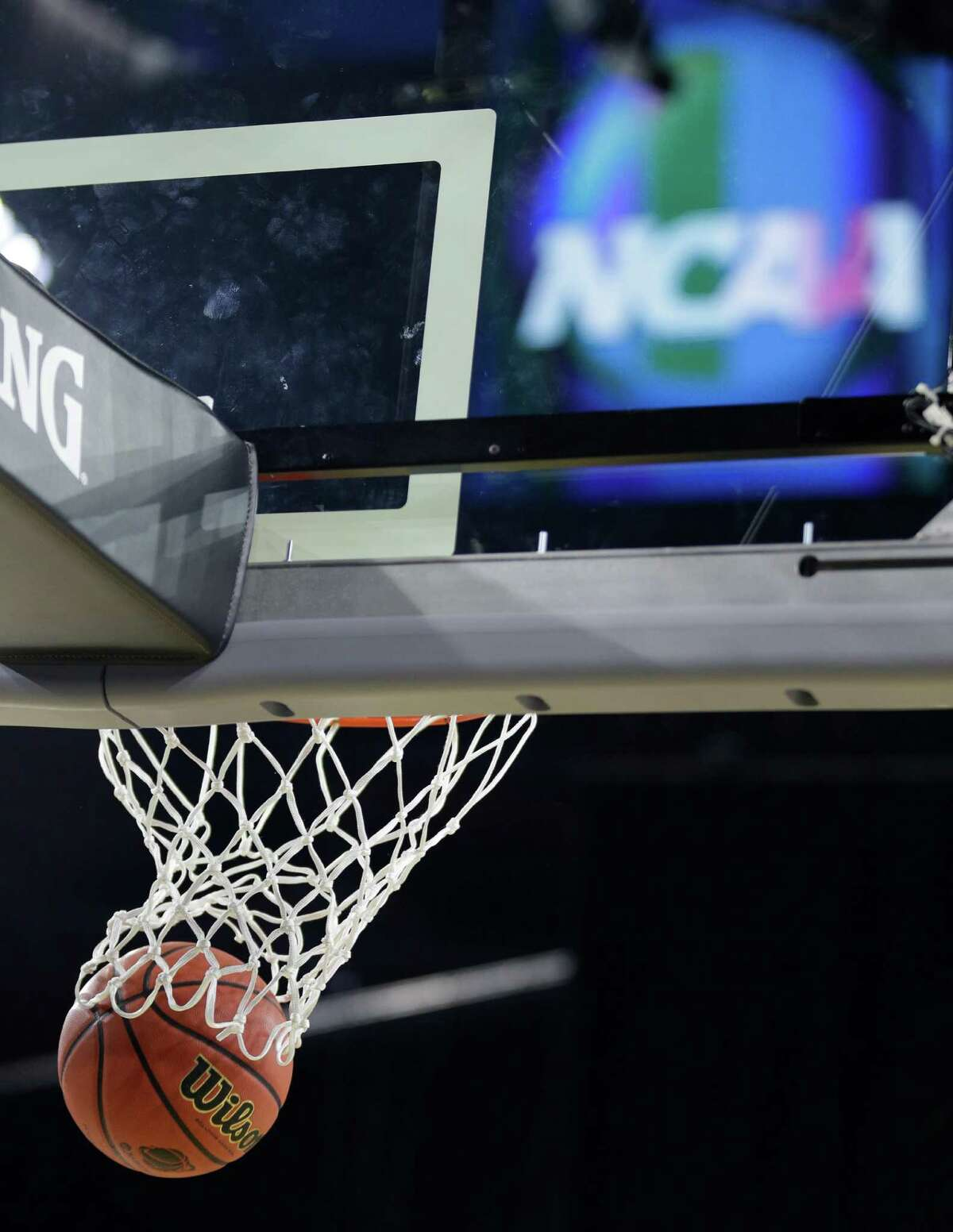 A basketball goes through the hoop during the Utah practice for the NCAA South Regional at NRG Stadium on Thursday, March 26, 2015, in Houston.