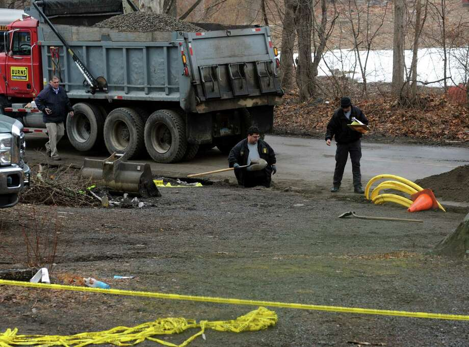 Police investigate a crime scene at Chopsey Hill Rd. and Pond St. in Bridgeport, Conn. Jose Araujo, of Milford, a worker with Burns Construction Co. was shot while on the job just after 9 a.m. on Thursday, March 26, 2015. Bridgeport police arrested 33-year-old Gregory Weathers Jr, 33, for the fatal shooting. Photo: Cathy Zuraw / Connecticut Post