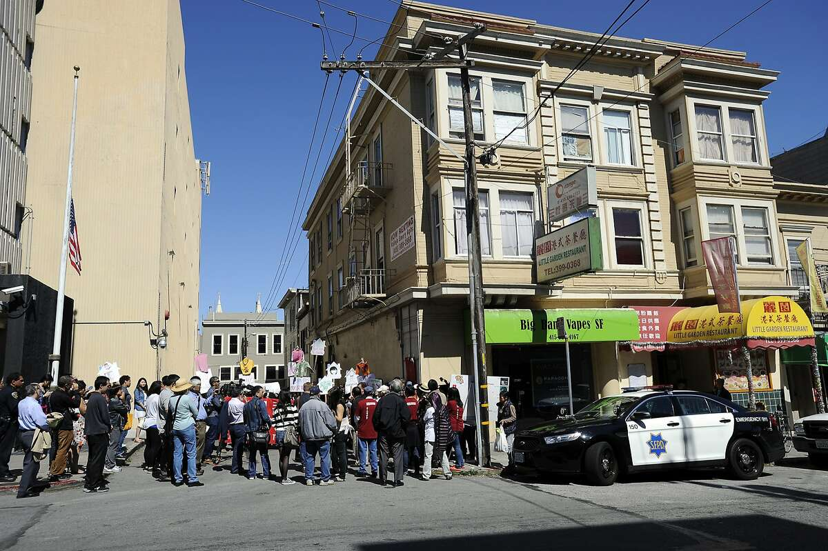 Tenants and activists protest in front of the Vallejo Emery Apartments in Chinatown who's owner they say is trying to evict longtime residents so that the rooms can be rented to higher paying tech workers, in San Francisco, CA, on Thursday, March 26, 2015.