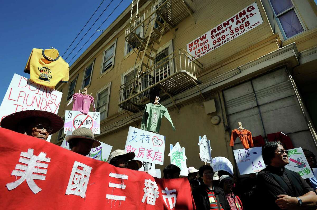 A sign advertising available rentals is seen as tenants and activists protest in front of the Vallejo Emery Apartments in Chinatown who's owner they say is trying to evict longtime residents so that the rooms can be rented to higher paying tech workers, in San Francisco, CA, on Thursday, March 26, 2015.