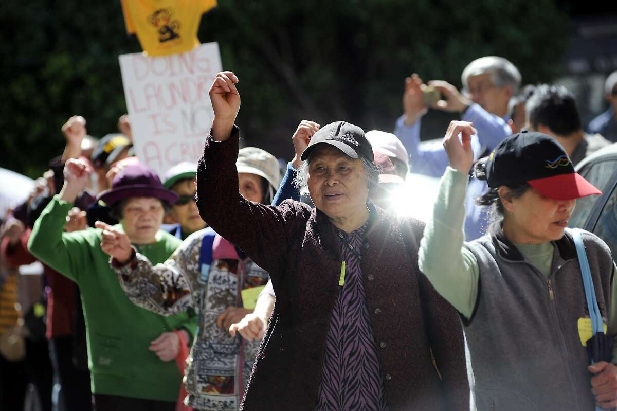 Tenants and activists march in protest in front of the Vallejo Emery Apartments in Chinatown who's owner they say is trying to evict longtime residents so that the rooms can be rented to higher paying tech workers, in San Francisco, CA, on Thursday, March 26, 2015.