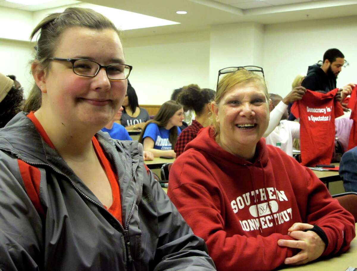 Meredith Peterson,21, of Clinton and Molly Donnolo, 48 of West Haven, both students at Southern Connecticut State Unviersity attend a rally to denounce the 4.8 percent tuition increase approved by the Board of Regents for Higher Education in Hartford, Conn. on Thursday, March 26, 2015.