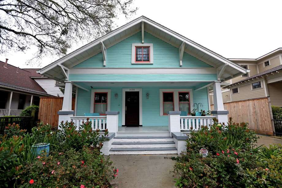 Peggy Gilbert painted the outside of her 1920s bungalow a Tiffany blue, a Sherwin-Williams shade called Spa. Photo: Gary Coronado, Staff / © 2015 Houston Chronicle