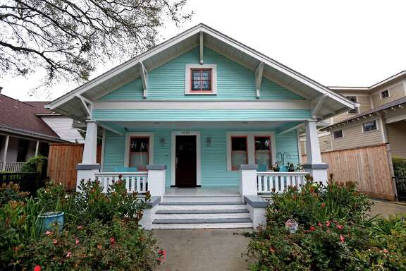 Peggy Gilbert painted the outside of her 1920s bungalow a Tiffany blue, a Sherwin-Williams shade called Spa.