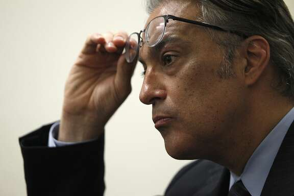 S.F. Sheriff Ross Mirkarimi listens in to public defender Jeff Adachi during a news conference about S.F. sheriff deputies staging cage-fight style matches between inmates for their entertainment and gambling purposes, pictured at the S.F. Public Defender's Office, Thursday, March 26, 2015, in San Francisco, Calif.