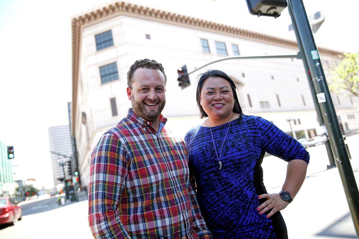 The Sears building in downtown Oakland, top, is being redesigned as a mix-use business space. The project is the brainchild of Loren Goodwin (left) and Ann Thai, above.