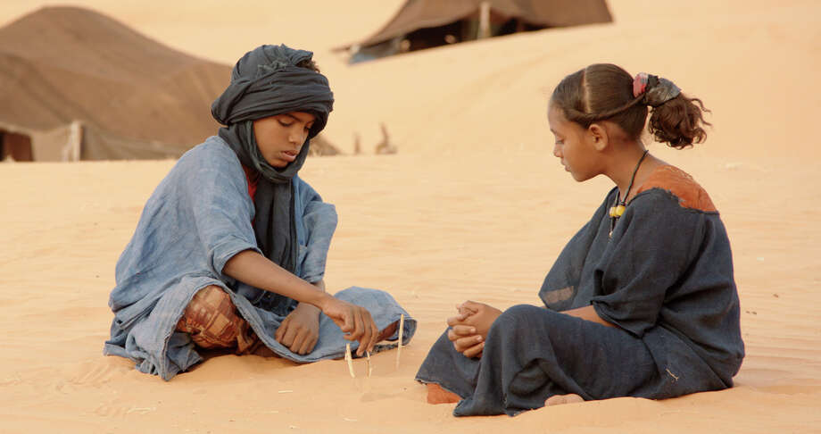 """(L-r) Issan (Mehdi A.G. Mohamed) and Toya (Layla Walet Mohamed) in """"Timbuktu."""" Illustrates FILM-TIMBUKTU-ADV13 (category e), by Ann Hornaday © 2015, The Washington Post. Moved Wednesday, Feb. 11, 2015. (MUST CREDIT: Cohen Media Group.) Photo: HANDOUT / THE WASHINGTON POST"""