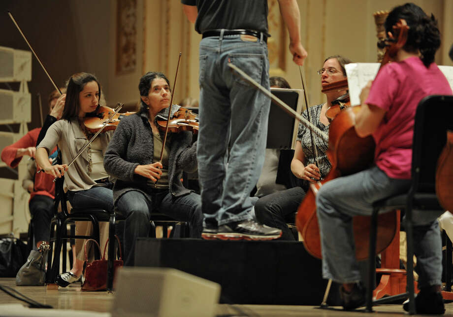 David Alan Miller conducts the Albany Symphony Orchestra during rehearsal before their debut concert at Carnegie Hall in New York Tuesday, May 10, 2011. (Lori Van Buren / Times Union archive) Photo: Lori Van Buren / 00012978A