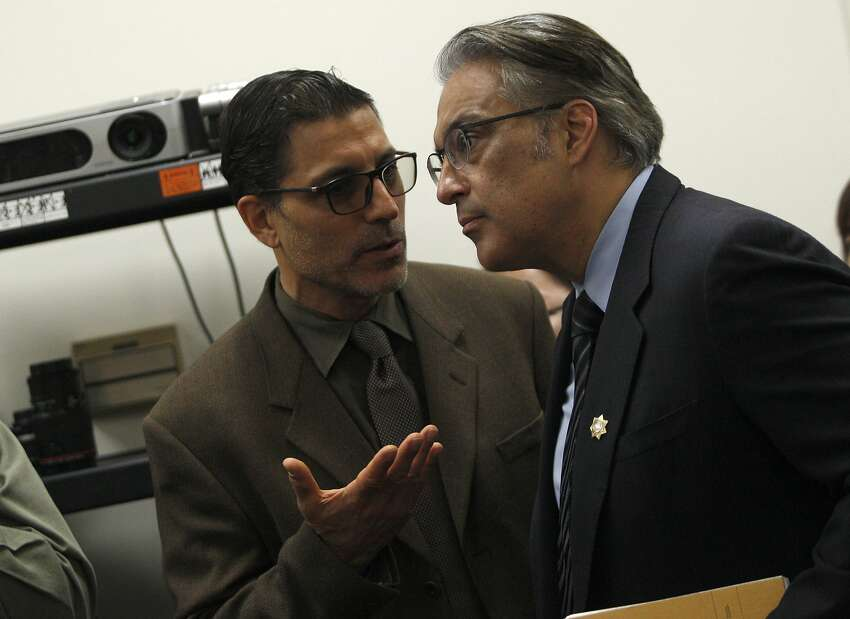 Directing attorney of S.F. Prisoner Legal Services, Nicholas Gregoratos (left) speaks to sheriff Ross Mirkarimi, during a news conference about S.F. sheriff deputies staging cage-fight style matches between inmates for their entertainment and gambling purposes, pictured at the S.F. Public Defender's Office, Thursday, March 26, 2015, in San Francisco, Calif.