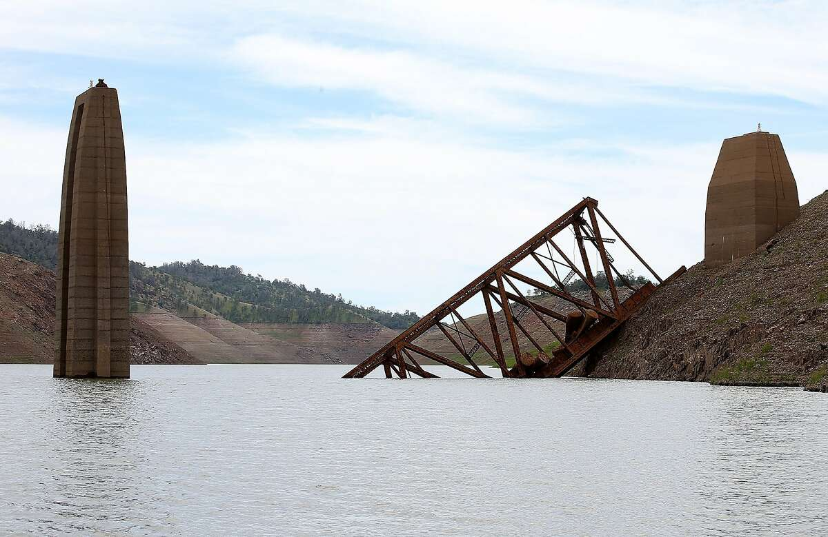 LA GRANGE, CA - MARCH 24: A section of the Barrett Bridge that was demolished after the Yosemite Valley Railraod went out of service in 1945 is visible as Lake McClure water levels decline on March 24, 2015 in La Grange, California. More than 3,000 residents in the Sierra Nevada foothill community of Lake Don Pedro who rely on water from Lake McCLure could run out of water in the near future if the severe drought continues. Lake McClure is currently at 7 percent of its normal capacity and residents are under mandatory 50 percent water use restrictions. (Photo by Justin Sullivan/Getty Images)