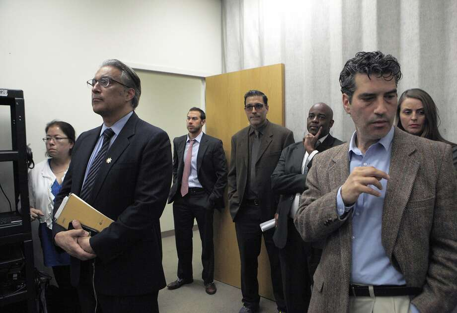 S.F. Sheriff Ross Mirkarimi (second from left) listens in to public defender Jeff Adachi during a news conference about S.F. sheriff deputies staging cage-fight style matches between inmates for their entertainment and gambling purposes, pictured at the S.F. Public Defender's Office, Thursday, March 26, 2015, in San Francisco, Calif. Photo: Santiago Mejia, The Chronicle