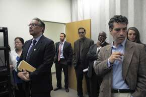 S.F. Sheriff Ross Mirkarimi (second from left) listens in to public defender Jeff Adachi during a news conference about S.F. sheriff deputies staging cage-fight style matches between inmates for their entertainment and gambling purposes, pictured at the S.F. Public Defender's Office, Thursday, March 26, 2015, in San Francisco, Calif.