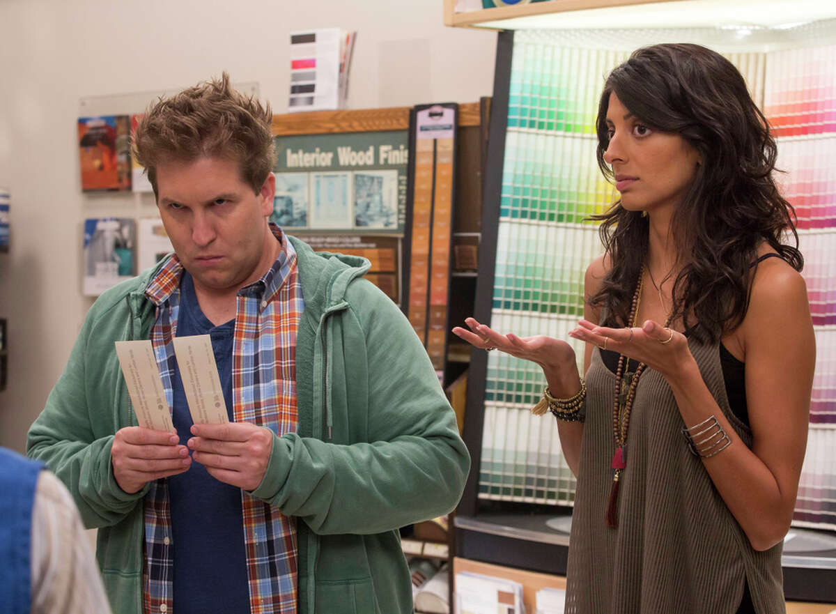 """Eric (Nate Torrence), who likes sock puppets, and Zara (Meera Rohit Kumbhani), who is easily bored, in """"Weird Loners."""""""