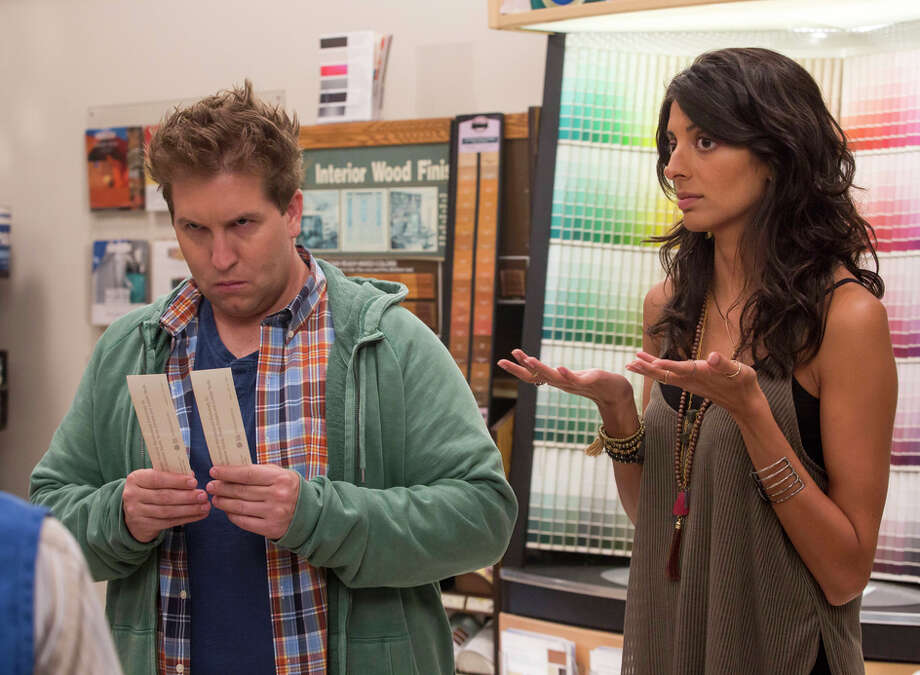 """Eric (Nate Torrence), who likes sock puppets, and Zara (Meera Rohit Kumbhani), who is easily bored, in """"Weird Loners."""" / ONLINE_YES"""